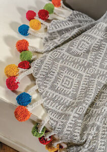 Grey recycled cotton throw with colourful pompoms | Ethical and sustainable