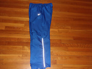 NIKE STORM-FIT BLUE ATHLETIC LINED WIND PANTS WOMENS LARGE EXCELLENT CONDITION