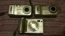 camera lot of 3 d-545 zoom Olympus (2) and fujifilm E510 (1)