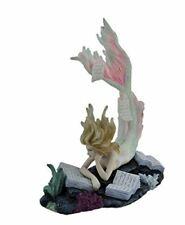 Lost Books Mermaid Sculpture by Tiffany Toland-Scott