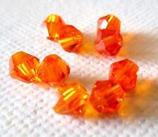 40 perles toupies cristal de swarovski colori orange 4mm