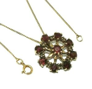 Ladies ornate 9ct yellow gold flower pendant set with amethysts on a curb chain