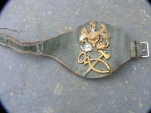 WWII  REME Officers  Wrist Insignia on green leather . original .