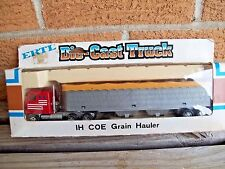 "ERTL #1238, ""TRUCKS OF WORLD"" RED INTERNATIONAL COE GRAIN HAULER IN BOX, 1:64"