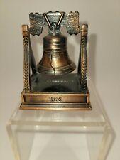 """Miniature Liberty Bell Pencil Sharpener Bronze Bell Swings 2.75"""" tall."""