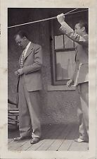 Vintage Antique Photograph Two Men In Suits On Porch Man Pulling on Clothes Line