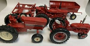 McCormick Farmall  & International Toy Tractors With  Wagon And Disk Plow Set