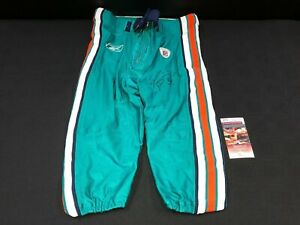 RICKY WILLIAMS MIAMI DOLPHINS SIGNED GAME USED REEBOK AQUA PANTS JSA WITNESS