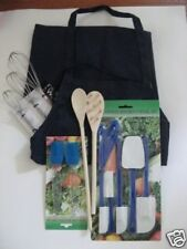 Kitchen Equipment: apron, whisks, spoons, brushes. New