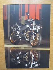 BUELL LIGHTENING PRINT SET ON HARDBOARD PERFECT FOR A GARAGE WALL OR WORKSHOP