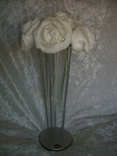 Artificial shimmering rose bouquet in tube vase