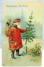 1910 FINNISH POSTCARD HAUSKAA JOULUA,CHRISTMAS,SANTA CLAUS CHOPS DOWN TREE