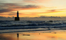 Framed Print - Lighthouse on the Shores of a Stormy Ocean (Picture Poster Art)