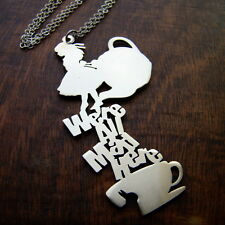 Alice in wonderland we're all mad here pendant in White Bronze