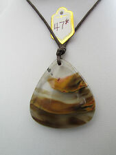 A STUNNING CHERRY QUARTZ PENDANT ON A WAXED CORD ADJUSTABLE NECKLACE.     (47*)