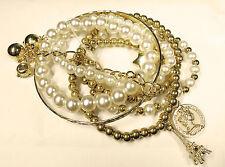 Bracciale vintage con Torre Eiffel penny inglese pendente a stella e perle finte