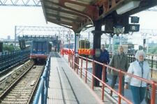 PHOTO  1994 STRATFORD THE RAILWAY STATION AGAIN WITH DLR AND BR EQUIPMENT PRESEN