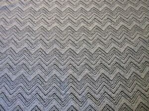 QUALITY UPHOLSTERY FABRIC IN A MODERN GEOMETRIC CHEVRON DESIGN IN GREY & BLACK.