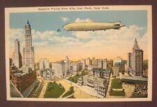 Zeppelin Flying Over City Hall Park, New York. - White Border Postcard
