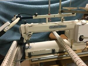 """Tin Lizzie Eighteen 18"""" quilting machine with table plus used good condition"""