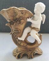 Antique vintage bisque vase of Cherub riding a cornucopia.