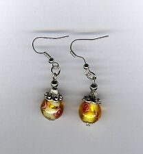 Lampwork yellow bead with brass hook and tibetan caps pierced earrings!