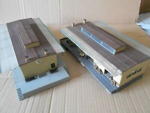 2X KIBRI HO STORAGE WAREHOUSES(one has internal lights)ramps,sliding doors etc.