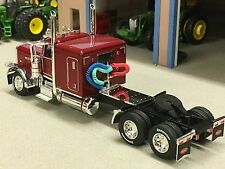 "1/64 DCP BURGUNDY 389 PRIDE-N-CLASS PETERBILT W/ 63"" SLEEPER"