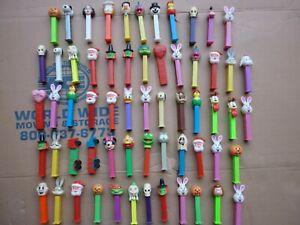 Pez lot of 63 Disney Semi Peanuts Santa