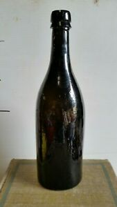 ANTIQUE THREE PIECE MOULD HAND BLOWN WITH APPLIED TOP BLACK GLASS WINE BOTTLE.