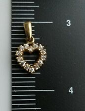 9 carat yellow gold heart shape pendant set with 14 white cubic zirconia  stones