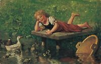 Happy girl laying on a footbridge with swimming ducks 01.70
