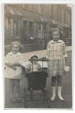 #114  RPPC Vintage Two young girls with Baby Doll in Carriage in neighborhood