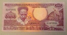 Suriname banconota. 100 GULDEN. FIOR. DATATO 1986.