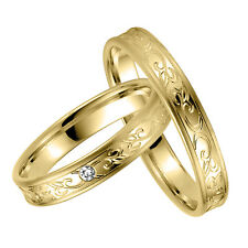 Wedding rings Rauschmayer 04813 in 585 Yellow gold with diamond 0.02 ct. w/si