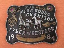 VTG 1984 PSU NIRA RODEO **CHAMPION STEER WRESTLER** TROPHY BELT BUCKLE-RUBY GEMS