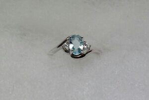 Beautiful 0.6 ctw simulated aquamarine and diamond ring size 2.5