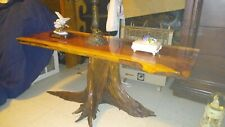 cedar wood table with drift wood holding up the glossed table made of cedar