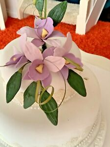 CELEBRATION  CAKE LILAC CAKE TOPPER CRAFTED IN SUGAR, PRICED TO CLEAR