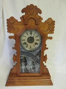 A Late 19th Century American Ansonia Gingerbread Clock with Alarm
