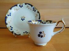ANTIQUE ROCKINGHAM PORCELAIN CUP AND SAUCER HAND PAINTED WITH BERRIES
