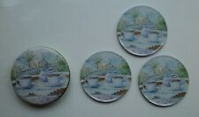 SET of THREE....COASTERS (metal/cork backed)....COMPLETE with TIN...