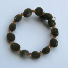Handmade Hawaiian mgambo seed bracelet with topaz color AB2X Swarovski bicones