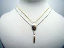 Collares y colgantes de joyería con diamantes brillantes de platino