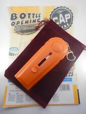 ORANGE CAP ZAPPA CAP LAUNCHER UP TO 5M! BOTTLE OPENER GREAT NOVELY WITH POUCH