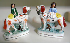 PAIR OF STAFFORDSHIRE STYLE PRINCE & PRINCESS ON DOGS FIGURINES
