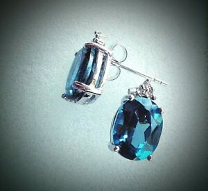 14K White Gold Over Sterling Silver Diamonds and 4.5 CTW London Blue Topaz Desig