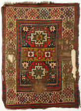 an antique and extraordinary Kazak Moghan Fragment Rug from around 1800.