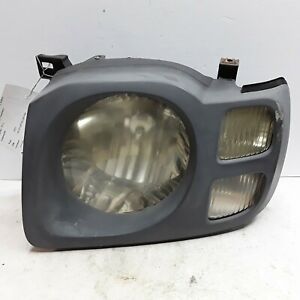 02 03 04 Nissan Xterra XE left driver side headlight assembly OEM