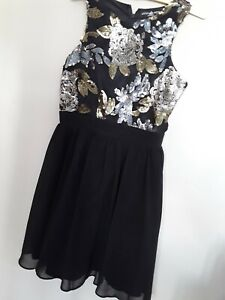 Little Mistress  fit and flare black dress with sequin detail size 12 💕